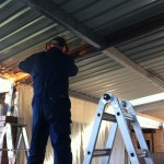 Keiran - cutting the steel rafter for some extra clearance