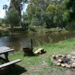 camp fires along river bank