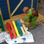 Riley helping paint his cubby