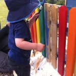 Lucas putting the finishing touches to the picket  fence